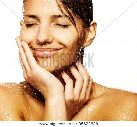 Close-up of beautiful wet woman face with water drop. On white background