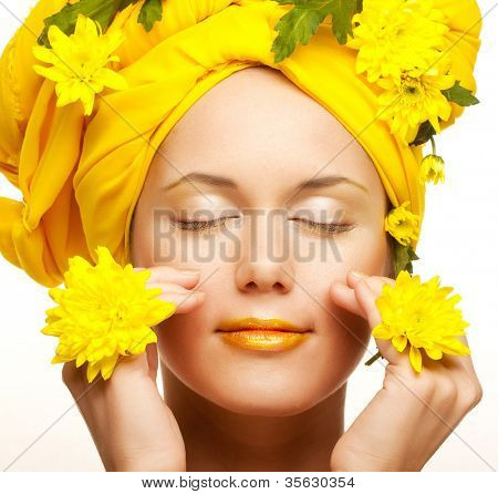 romantic image of a young woman with yellow chrysanthemums