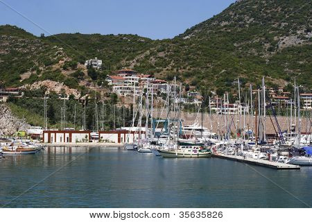 View on small bay with yachts and boats on Mediterranean Sea in popular touristic city of Kemer, Turkey.