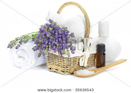 lavender spa (fresh lavender flowers in a basket,  essential oil, salt,  Herbal massage balls) over white