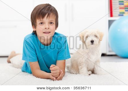 Young boy and his good behaving doggy together indoors