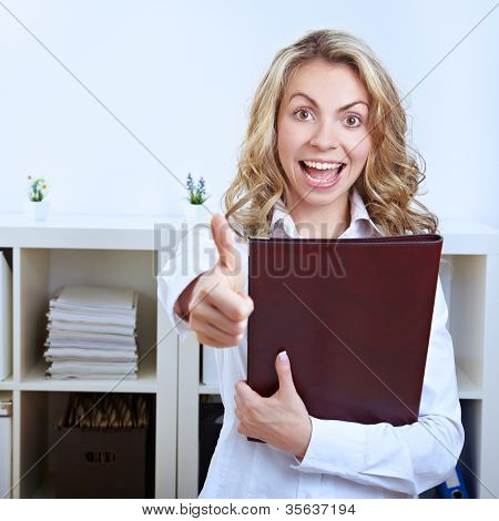 Female happy job candidate with CV holding her thumbs up