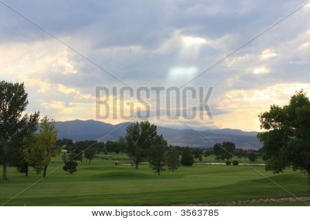 Beam Of Light Shining Down On A Golf Course