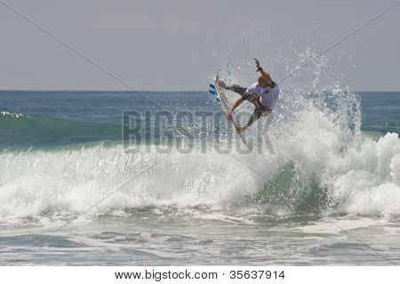 HUNTINGTON BEACH, CA - AUGUST 2: Stu Kennedy competes in the Nike US Open of Surfing in Huntington Beach, CA on August 2, 2012