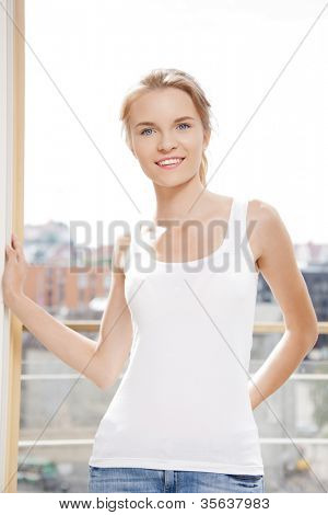 picture of happy teenage girl at the window