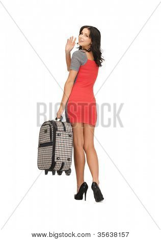 picture of happy woman with suitcase waving hand