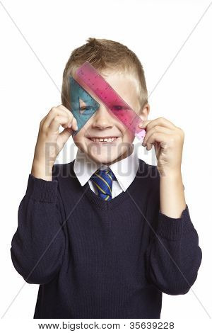8 Year Old School Boy With Set Square And Protractor On White Background