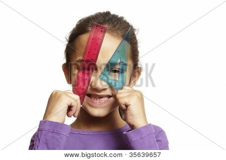 8 Year Old School Girl With Pink Ruler And Blue Setsquare On White Background
