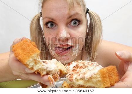 The girl greedy eats sweet pie. Unhealthy lifestyle (bulimia) concept.
