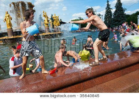 "MOSCOW - JULY 14: Young people shooting and throwing water at each other during flash mob ""Water Battle"" near People??s Friendship Fountain in VDNKH on July 14, 2012 in Moscow."