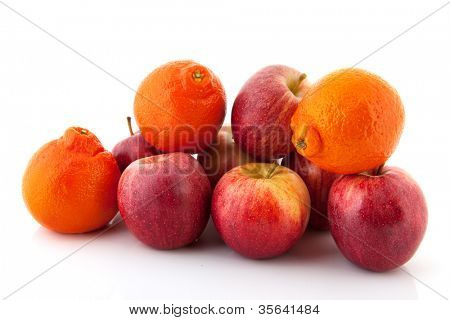 Fresh red apples and oranges on white background