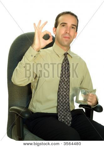 Businessman Sitting With Coffee