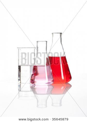 Laboratory flasks - Clear liquid mixed with a red colored chemical reagent, isolated
