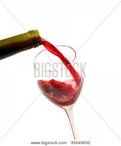 glass filled with red wine on white background,tilted