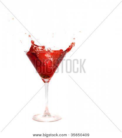 splashing strawberry into a cocktail glass