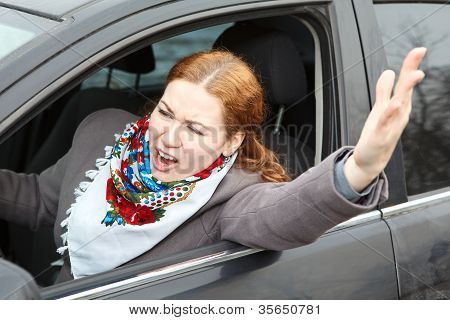 Pretty Young Caucasian Woman Shaking Hers Hand And Screaming Sitting In Car