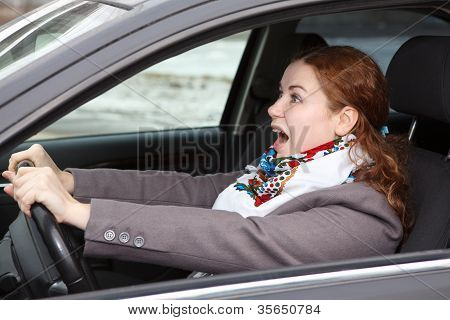 Pretty Young Caucasian Woman Stopping The Car And Screaming  Looking Forward