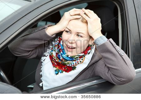 Pretty Young Expression Caucasian Woman Holding Head By Hands Sitting In Car
