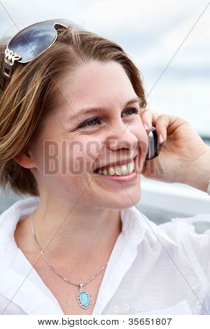 Happy Woman In White Shirt With Sunglasses Calling On Mobile Phone. Close Up