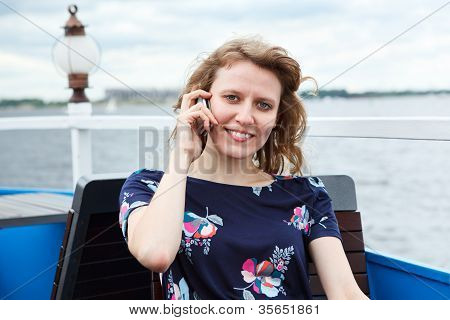 Pretty Caucasian Woman Sitting With Mobile Phone