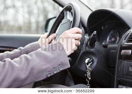 Female Hands On Steering Wheel In Land Vehicle