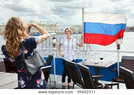 Woman Photographing With Russian Flag On Ship Deck