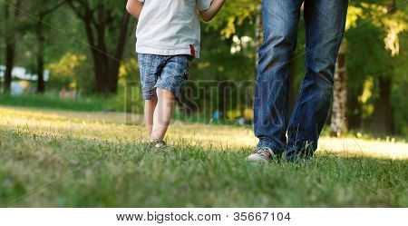 Father And Son Legs Walk In The Park 1