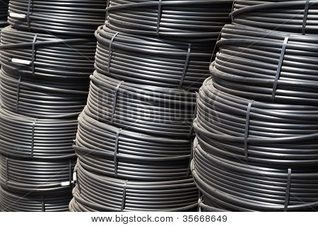 stacks of rolled hoses