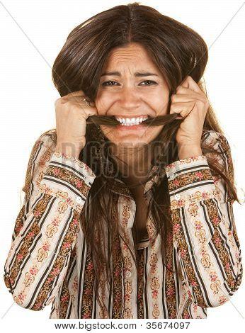 Frantic Woman Biting Her Hair