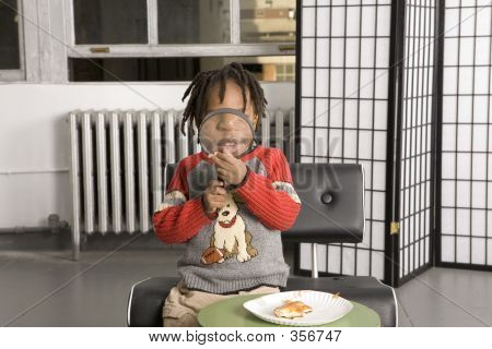 Child Playing With A Magnifying Glass