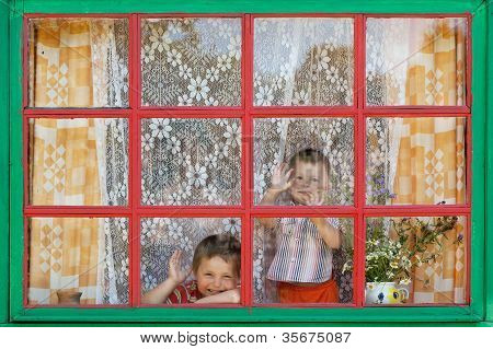 Two Boys Sit By The Window