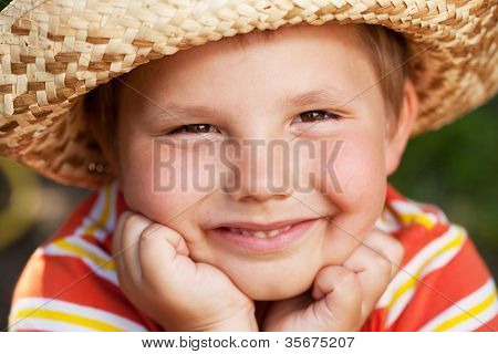 Brown-eyed Boy In A Wicker Hat And Shirt