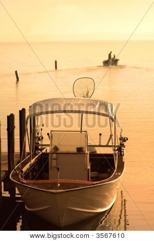Boat In The Early Morning Sun Light