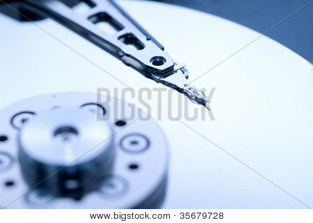close up macro of an opened computer harddrive.