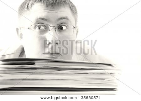 Bisness man Drowning in paper