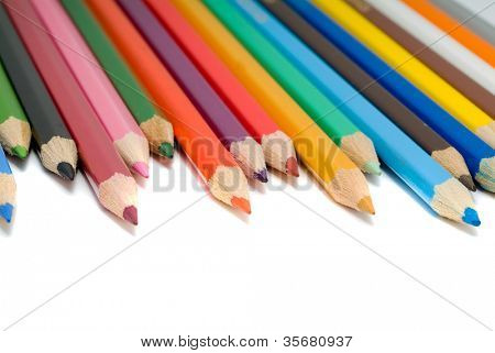 coloured pencils with shadow on white background