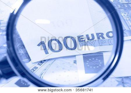 Banknotes through a magnifier.