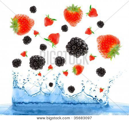 Berries falling in water. Isolation on the white