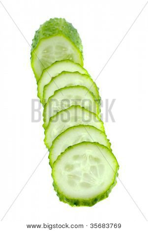 cucumber cut by segments. Isolation on white.