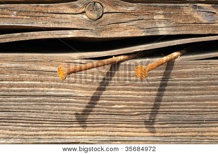 Rusty Nails In Wooden Plank