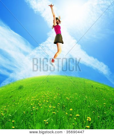 Happy jumping woman against the blue sky.