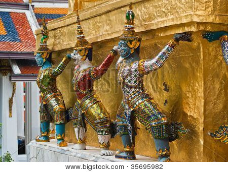 Giants Sculpture Standing In Front Of Pagoda In The Royal Grand Palace, Bangkok, Thailand