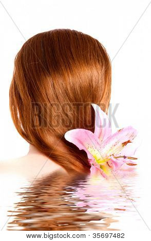 young beautiful spa woman with  lilly