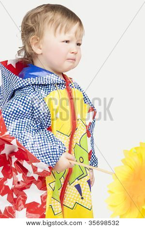 Sad And Crying Little Girl In Raincoat