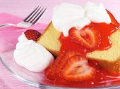 picture of pound cake  - Sliced pound cake topped with fresh strawberries strawberry glaze and whipped cream - JPG