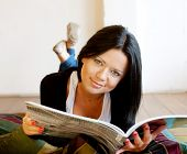 young woman is reading the magazine