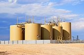 stock photo of oilfield  - Storage tanks for crude oil in central Colorado - JPG