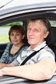 Close Up Of Senior Caucasian Couple Sitting In Domestic Car And Smiling poster
