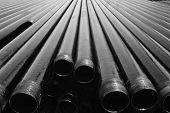 stock photo of oil drilling rig  - Drill pipes with petroleum cover on it - JPG