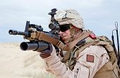 stock photo of grenades  - US marine aiming a gun with grenade launcher - JPG